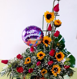 Birthday arrangement in Roses and Sunflowers